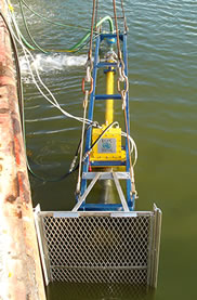 submersible skimmer in water for BP's trials with EVTN